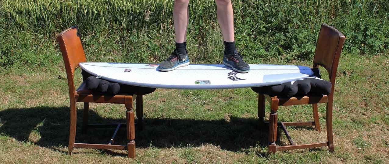 Lib Tech x Lost Surfer standing on surfboard